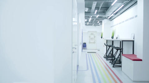 Light corridor of office space in white in a loft style. Workplace Footage
