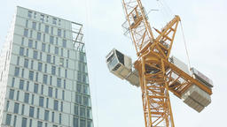 Construction Crane and Modern Building Tower Live Action