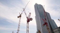 Construction Cranes and Office Tower from Low Angle Footage