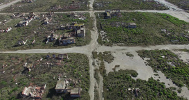 Aerial drone scene of destroyed, demolished, city, neighborhood camera flying sl Footage