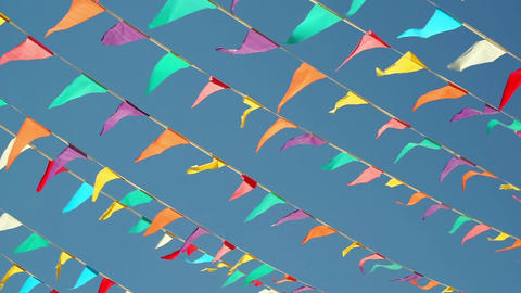 String Pennant Flags Against Blue Sky Footage