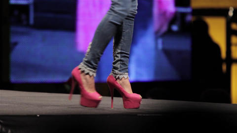 Legs of mannequins which marching on stage during a fashion 15 Footage