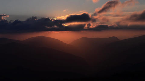 Overcast sunrise over high mountains and deep valleys 09 Footage