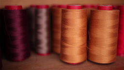 several wool rolls of different colors for sewing Footage