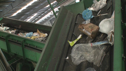 trash to recycle in a conveyor belt Footage