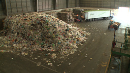 loeders working in warehouse of recycling industry Footage