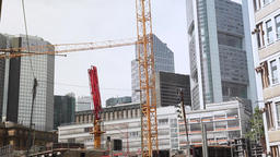 Financial District Buildings and Construction Cranes at Work Live Action