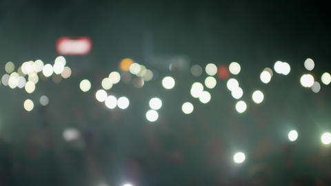 Crowd waving flashlights during a music event, Live Action