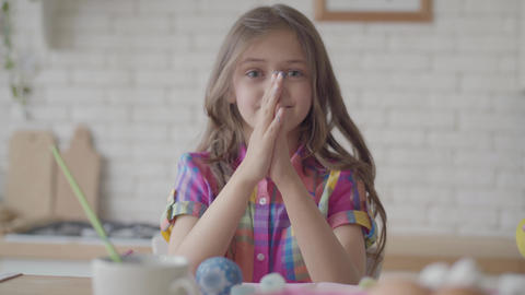 Portrait funny cute emotional little girl showing hands in the blue paint Footage