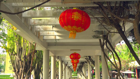 Row of Chinese lanterns over promenade Live Action