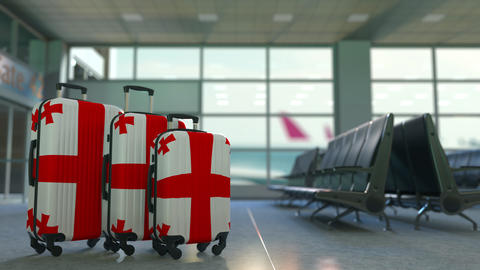 Travel suitcases with flag of Georgia. Georgian tourism conceptual animation Live Action