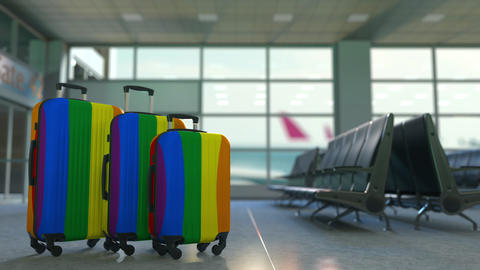 Travel suitcases with gay pride flag. LGBT tourism or immigration conceptual Footage