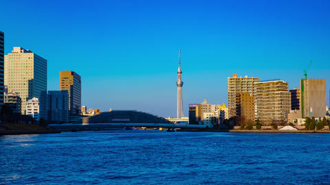Sunset timelapse day to night at Sumida river in Tokyo panning Footage