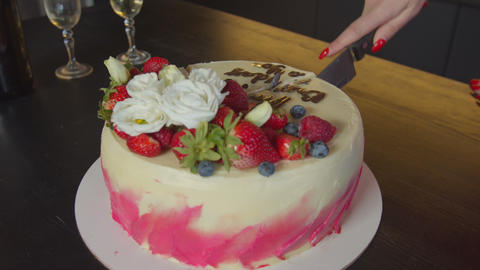Female hand with knife cutting tasty birthday cake Footage
