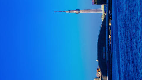 Sunset timelapse day to night at Sumida river in Tokyo vertical tilt Footage
