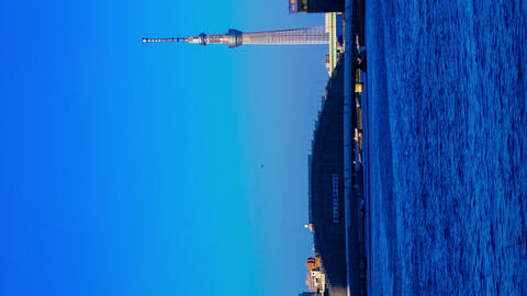 Sunset timelapse day to night at Sumida river in Tokyo vertical zoom Footage