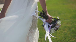 Bouquet in the hands of the bride. Beautiful girl touches his hand Footage