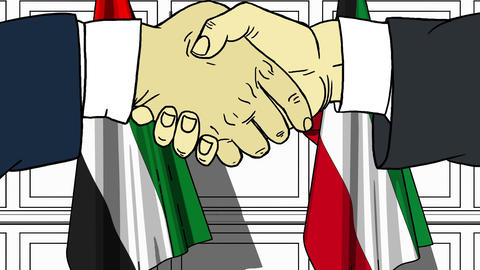 Businessmen or politicians shake hands against flags of UAE and Kuwait. Official Footage