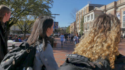 CHAPEL HILL, NC, USA - CIRCA NOV 2018 - Two female university college students walking to class Live Action