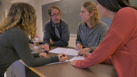 Push in of a professor teaching young high school or college university students math and science Footage
