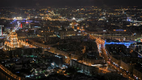 Static aerial view - fast moving cars traffic at night city street Archivo
