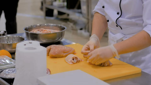 Cook cutting chicken meat with knife Footage