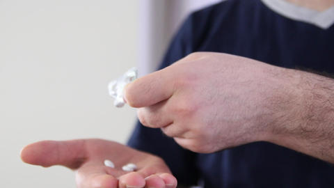 hand take pills from blister pack Live Action
