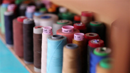 Several Wool Rolls Of Different Colors For Sewing stock footage