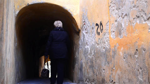Pedestrian traffic in a passage that ends with a tunnel under a house 02 Footage