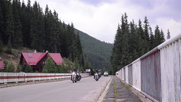 Group of bikers passing over a concrete bridge on their journey 18 Footage