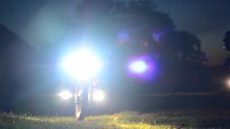 Group of motorcyclists who enter the yard from the headlights 05 Footage