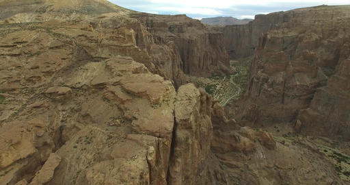 Aerial drone scene of big canyon in Patagonia, Argentina. Camera moves along the Footage