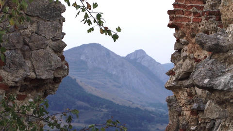 Ruins of a fortress beyond that I see mountains 05 Footage