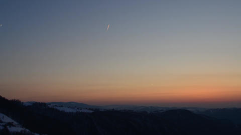 Sunrise over the mountains high with many planes cross the sky clear 01 Footage
