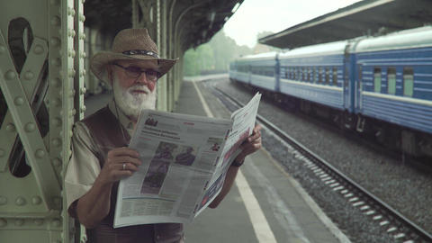 Mature Man Reading A Newspaper stock footage