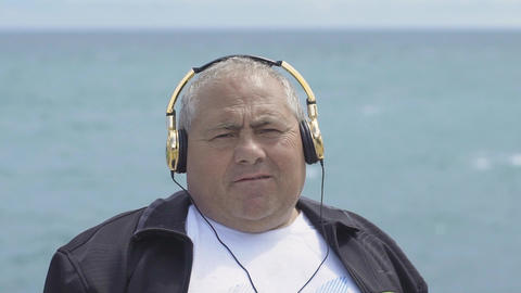 Man In Headphones Listens To Music Footage