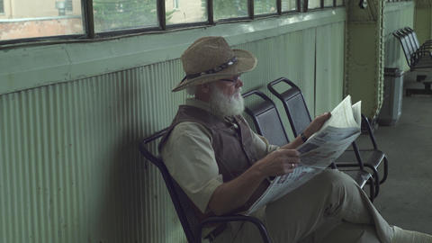 Old Man Reading A Newspaper Footage