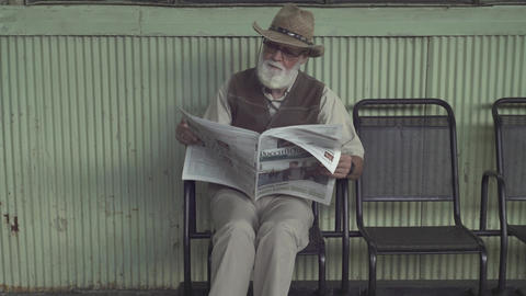Elder Man With Newspaper Footage