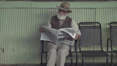 Elder Man With Newspaper stock footage