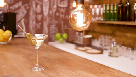 A glass of martini on a bar counter in an empty... Stock Video Footage