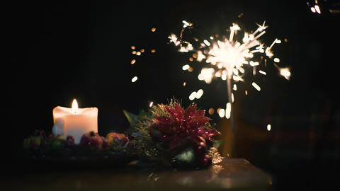 Christmas candle with Bengal fire on a black background in super slow motion Footage