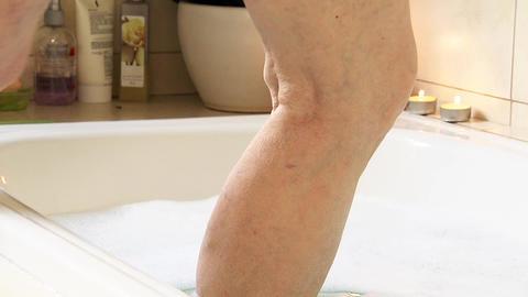Elderly Woman Foot On Bathtub Water GIF