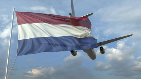 Airliner flying over waving flag of the Netherlands. 3D animation Footage