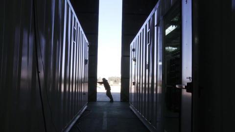WORKER OPENING WAREHOUSE DOOR 0