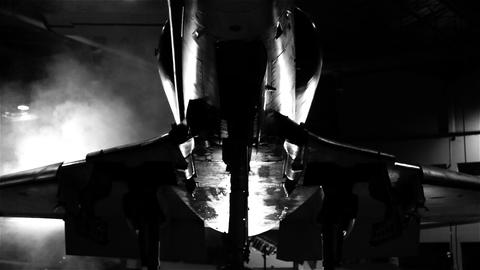 Combat Aircraft In A Hangar. Black And White Tone. Pan Shot Live Action