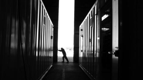WORKER OPENING WAREHOUSE DOOR 1