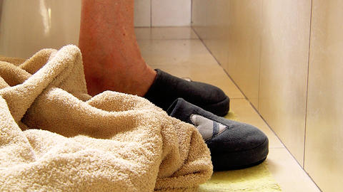 Old Woman's Feet In Slippers Entering The Bathtube Live Action