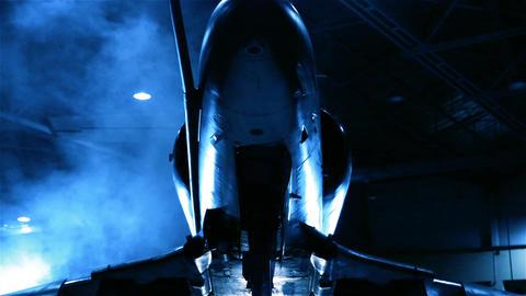 Fighter Plane Inside A Military Hangar Awaiting Deployment ビデオ