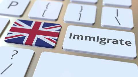 IMMIGRATE text and flag of Great Britain on the buttons on the computer keyboard Live Action