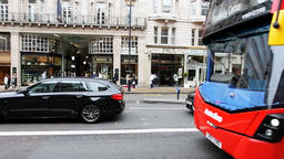 Slow motion of Piccadilly street, arcade, cars, bus in London street, UK Footage